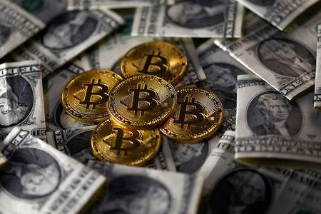Президент банка «Открытие» сравнил биткоин с «МММ»